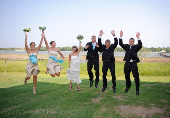 """""""Okay, everyone just jump and throw your hands up!  Kim, don't worry about your black flip flops, we can photoshop them out!"""" (or not)"""