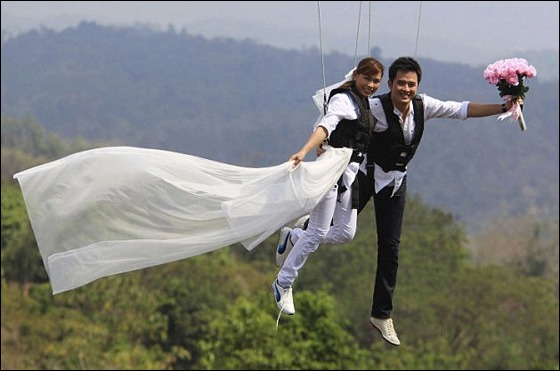 """Lol, Ron and Laura are so funny you guys! They went bungee jumping for their vows!"""