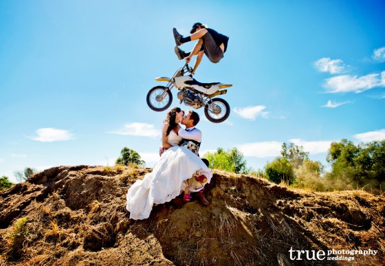 """Let's incorporate our love of extreme cycling into our wedding pics."""